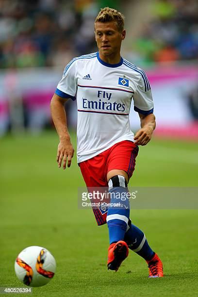 Matthias Ostrzolek of Hamburg runs with the ball during the Telekom Cup 2015 Semi Final match between Borussia Moenchegladbach and Hamburger SV at...