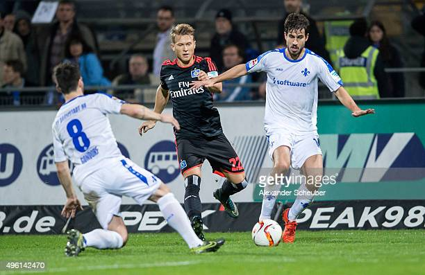 Matthias Ostrzolek of Hamburger SV challenges Jerome Gondorf of SV Darmstadt 98 and Gyoergy Garics of SV Darmstadt 98 during the first bundesliga...