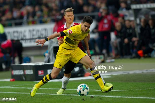 Matthias Ostrzolek of Hannover 96 and Marc Bartra Aregall of Borussia Dortmund battle for the ball during the German Bundesliga match between...