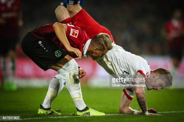 Matthias Ostrzolek of Hannover and Andre Hahn of Hamburg compete for the ball during the Bundesliga match between Hannover 96 and Hamburger SV at...