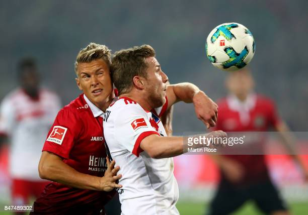 Matthias Ostrzolek of Hannover and Sven Schipplock of Hamburg battle for the ball during the Bundesliga match between Hannover 96 and Hamburger SV at...