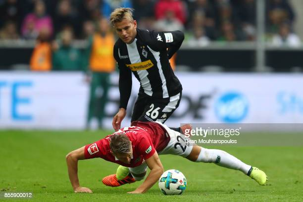 Matthias Ostrzolek of Hannover fights for the ball with Raul Bobadilla of Moenchengladbach during the Bundesliga match between Borussia...