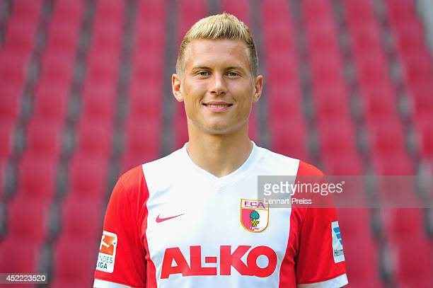 Matthias Ostrzolek poses during the team presentation of FC Augsburg at SGL Arena on July 16 2014 in Augsburg Germany