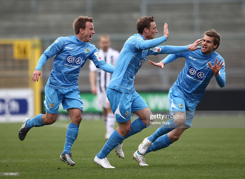 Matthias Pessolat of Chemnitz celebrates with team mates after scoring his team's second goal during the Third League match between VfR Aalen and...