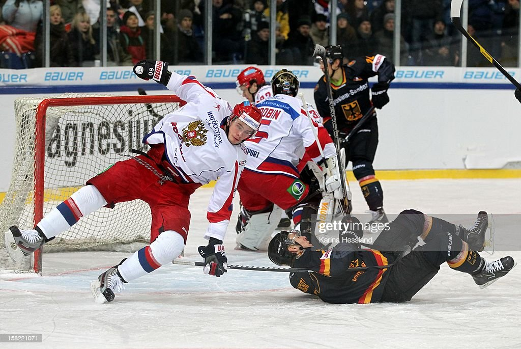 Matthias Plachta of Germany challenges Dmitry Maltsev of Russia during the Top Teams Sochi match between Germany and Russia at Kuechwaldhalle on December 11, 2012 in Chemnitz, Germany.