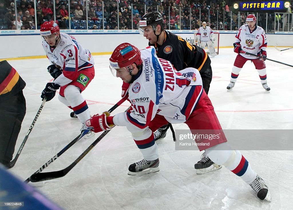 Matthias Plachta of Germany challenges Vladimir Zharkov of Russia during the Top Teams Sochi match between Germany and Russia at Kuechwaldhalle on December 11, 2012 in Chemnitz, Germany.