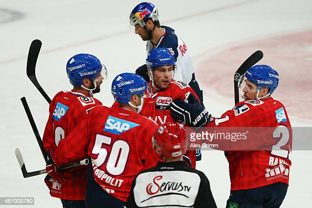 Matthias Plachta of Mannheim celebrates his team's second goal with team mates during the DEL match between Adler Mannheim and EHC Red Bull Muenchen...