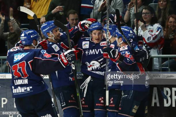 Matthias Plachta of Mannheim celebrates his team's second goal with team mates during the DEL Playoffs quarter finals Game 1 between Adler Mannheim...