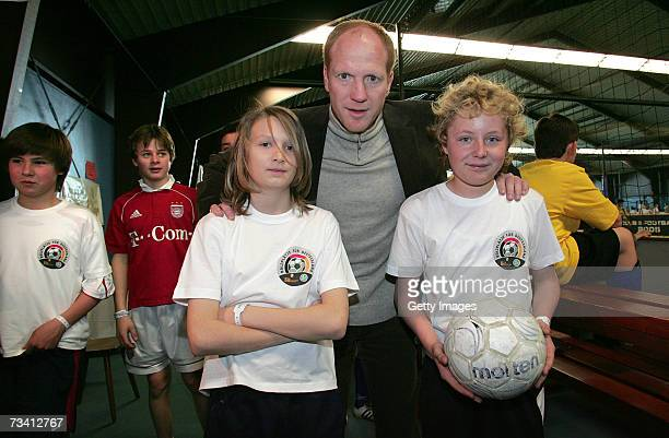 Matthias Sammer and children during the 'Play Soccer Get Together' charity tournament sponsored by Bitburger on February 24 2007 in Munich Germany