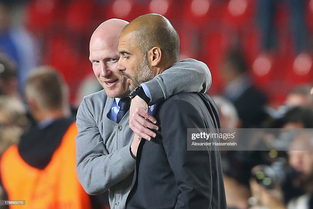 <a gi-track='captionPersonalityLinkClicked' href=/galleries/search?phrase=Matthias+Sammer&family=editorial&specificpeople=555228 ng-click='$event.stopPropagation()'>Matthias Sammer</a> (L), sporting director of Bayern Muenchen celebrates with head coach Pep Guardiola after winning the UEFA Super Cup between FC Bayern Muenchen and Chelsea FC at Stadion Eden on August 30, 2013 in Prague, Czech Republic.