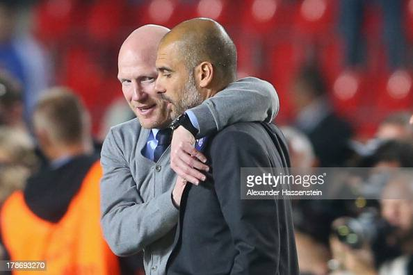 Matthias Sammer sporting director of Bayern Muenchen celebrates with head coach Pep Guardiola after winning the UEFA Super Cup between FC Bayern...