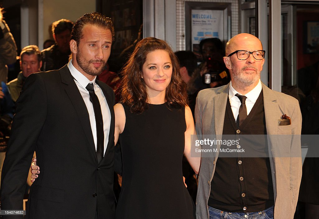 <a gi-track='captionPersonalityLinkClicked' href=/galleries/search?phrase=Matthias+Schoenaerts&family=editorial&specificpeople=6259320 ng-click='$event.stopPropagation()'>Matthias Schoenaerts</a>, <a gi-track='captionPersonalityLinkClicked' href=/galleries/search?phrase=Marion+Cotillard&family=editorial&specificpeople=215303 ng-click='$event.stopPropagation()'>Marion Cotillard</a> and <a gi-track='captionPersonalityLinkClicked' href=/galleries/search?phrase=Jacques+Audiard&family=editorial&specificpeople=624567 ng-click='$event.stopPropagation()'>Jacques Audiard</a> attend the premiere of 'Rust and Bone' during the 56th BFI London Film Festival at Odeon West End on October 13, 2012 in London, England.