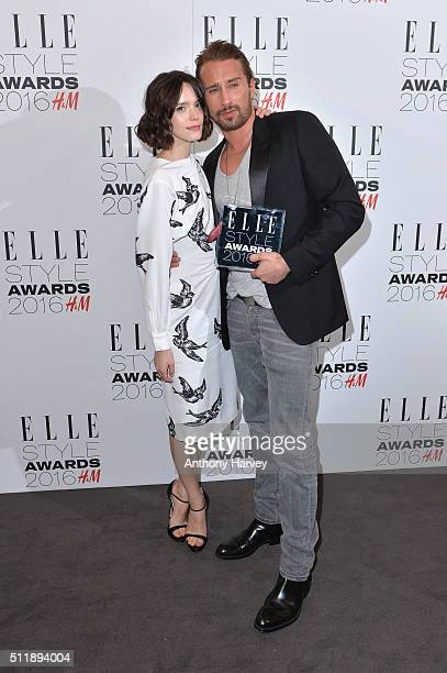 Matthias Schoenaerts poses with his award for Actor of The Year with Stacy Martin in the winners room at The Elle Style Awards 2016 on February 23...