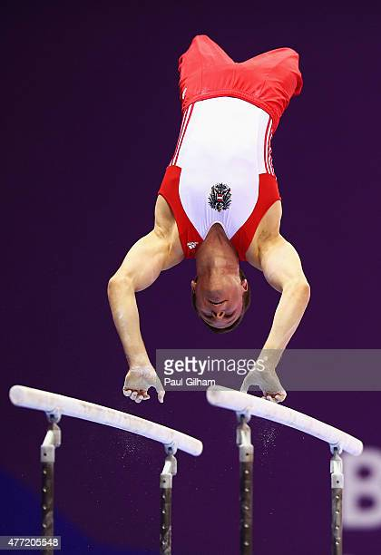 Matthias Schwab of Austria competes on the parallel bars during the Men's Artistic Gymnastics Team and All Around qualification on day three of the...