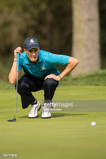 Matthias Schwab of Austria from the European Team lines up his putt on the second green during the morning singles for the 8th Junior Ryder Cup at...
