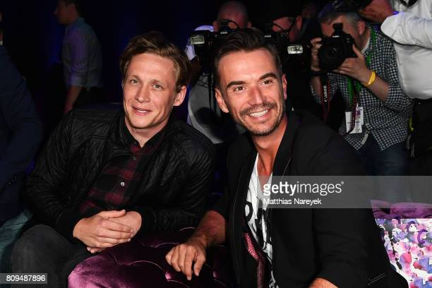 Matthias Schweighoefer and Florian Silbereisen attend the Guido Maria Kretschmer Fashion Show Autumn/Winter 2017 at Tempodrom on July 5 2017 in...
