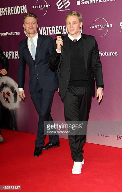 Matthias Schweighoefer holds a Gopro camera at the premiere of the film 'Vaterfreuden' at Mathaeser Filmpalast on January 29 2014 in Munich Germany