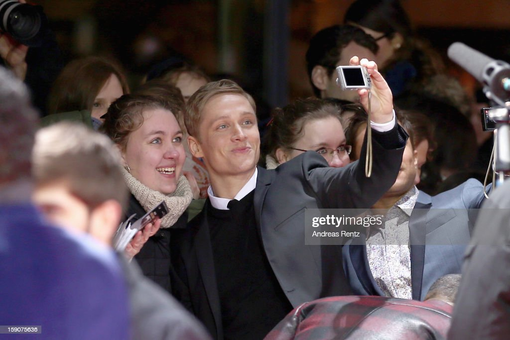 Matthias Schweighoefer poses with a fan at the 'Der Schlussmacher' Berlin Premiere at Cinestar Potsdamer Platz on January 7, 2013 in Berlin, Germany.