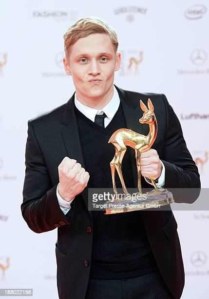 Matthias Schweighoefer poses with the Bambi for best film at Stage Theater on November 14 2013 in Berlin Germany