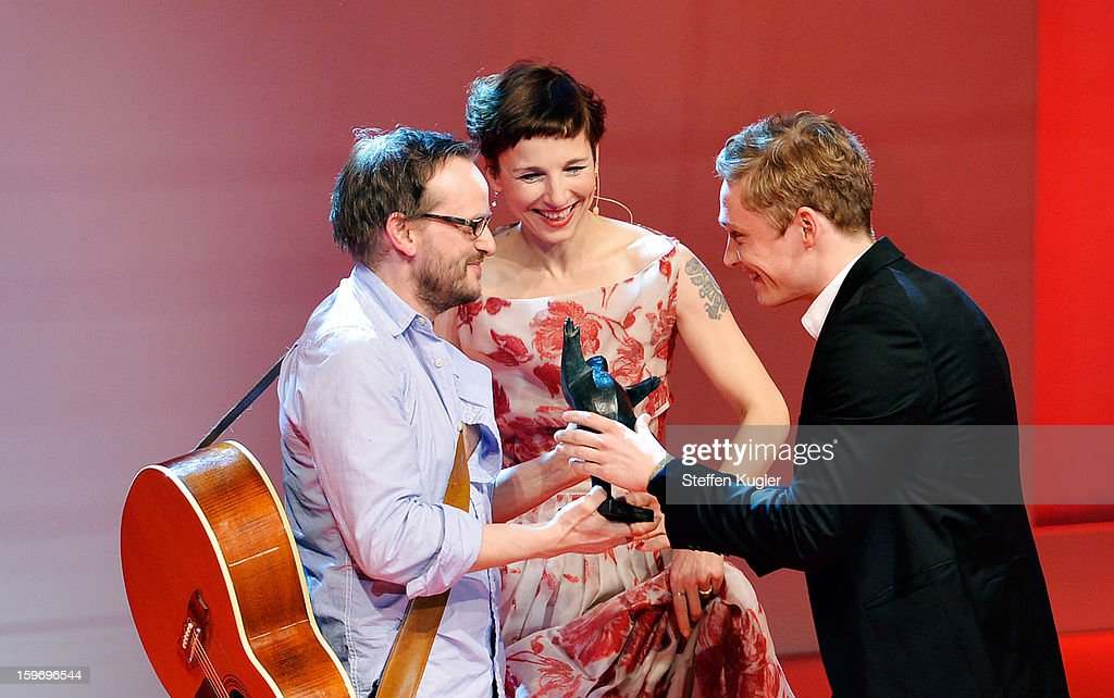 Matthias Schweighoefer (R) receives the B.Z. Kulturpreis from his friend and laudator Milan Peschel (l) while Meret Becker (c) stands by on January 18, 2013 in Berlin, Germany.