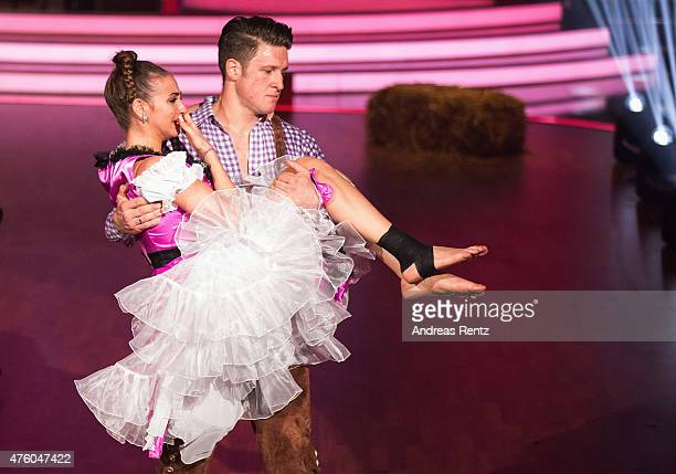 Matthias Steiner holds Ekaterina Leonova after her injury during the final show of the television competition 'Let's Dance' on June 5 2015 in Cologne...