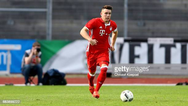 Matthias Stingl of Bayern runs with the ball during the U19 German Championship Semi Final second leg match between FC Schalke and FC Bayern at...