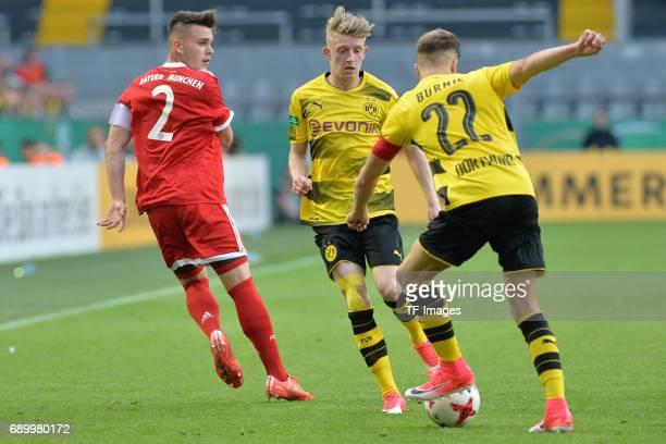 Matthias Stingl of Munich JanNiklas Beste of Dortmund and Dzenis Burnic of Dortmund battle for the ball during the U19 German Championship Final...