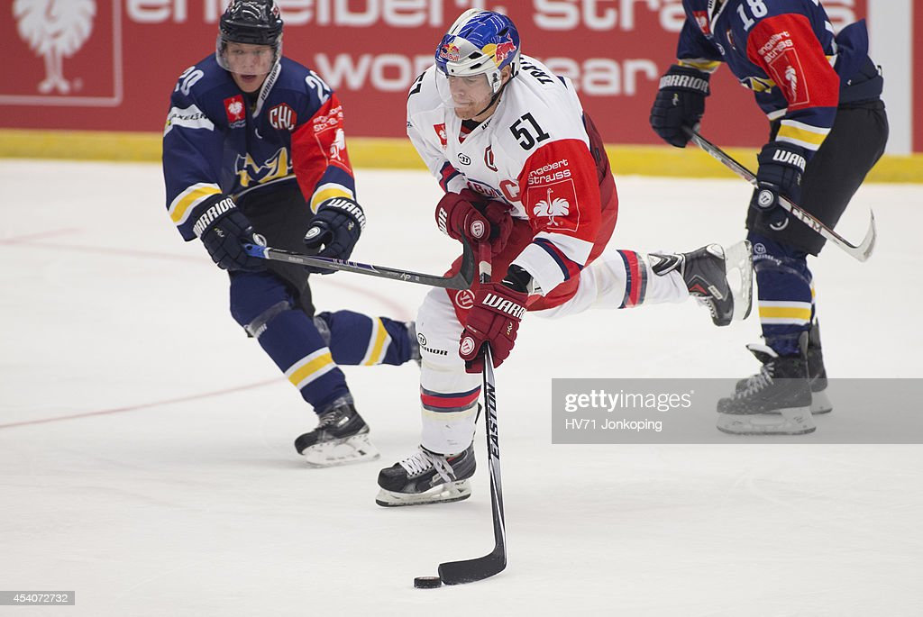 Matthias Trattnig #51 of Red Bull Salzburg takes a shot on goal during the Champions Hockey League group stage game between HV71 Jonkoping and Red Bull Salzburg on August 24, 2014 in Jonkoping, Sweden.