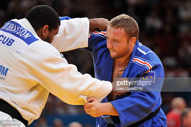 Matthieu Bataille of France fights against Oscar Brayson of Cuba during the elimination round of the men's over 100kg category of the World Judo...