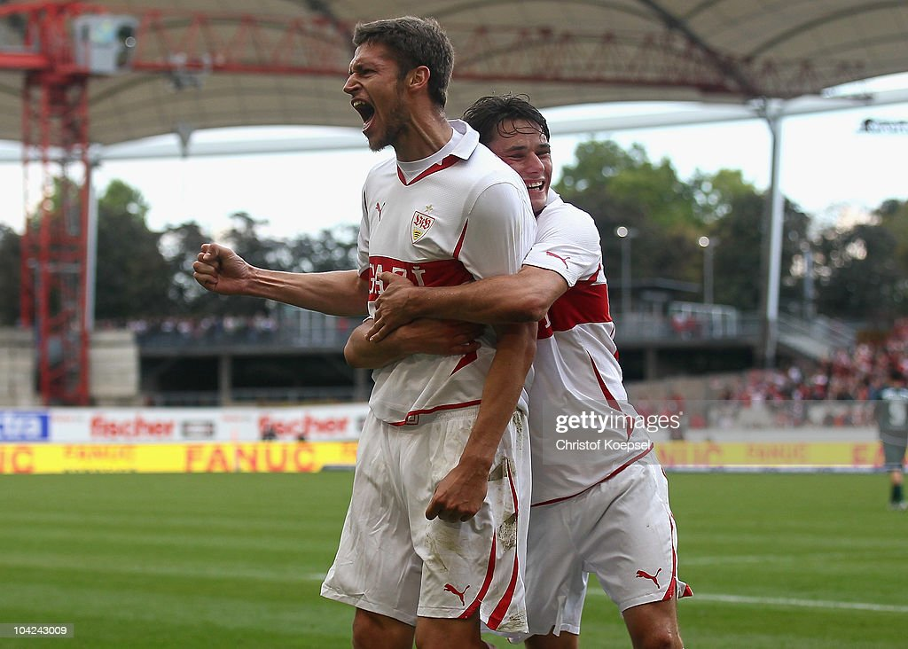 Matthieu Delpierre of Stuttgart (L) celebrates the sixth goal with Christian Traesch of Stuttgart (R) during the Bundesliga match between VfB Stuttgart and Borussia Moenchengladbach at Mercedes-Benz Arena on September 18, 2010 in Stuttgart, Germany.