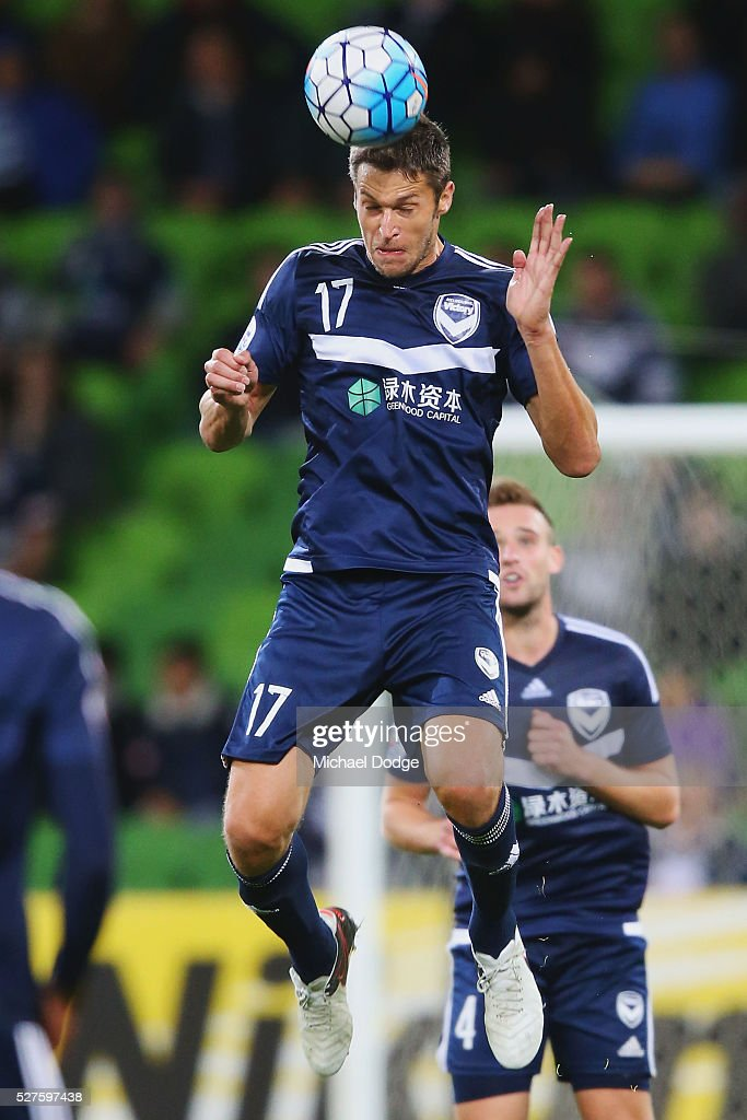Matthieu Delpierre of the Victory heads the ball during the AFC Champions League match between Melbourne Victory and Gamba Osaka at AAMI Park on May 3, 2016 in Melbourne, Australia.