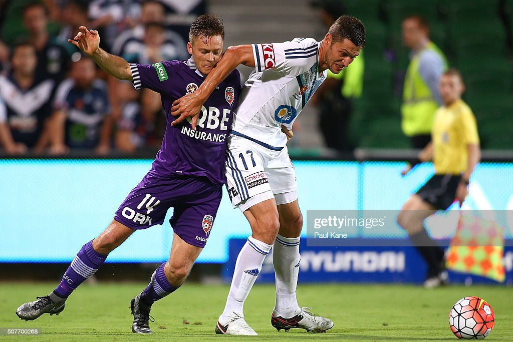Matthieu Delpierre of the Victory holds Chris Harold of the Glory off the ball during the round 17 A-League match between Perth Glory and Melbourne Victory at nib Stadium on January 30, 2016 in Perth, Australia.