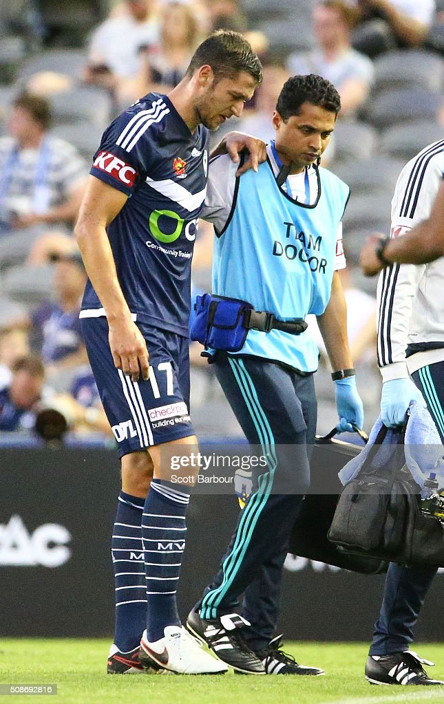 Matthieu Delpierre of the Victory leaves the field injured during the round 18 A-League match between the Melbourne Victory and Western Sydney Wanderers at Etihad Stadium on February 6, 2016 in Melbourne, Australia.