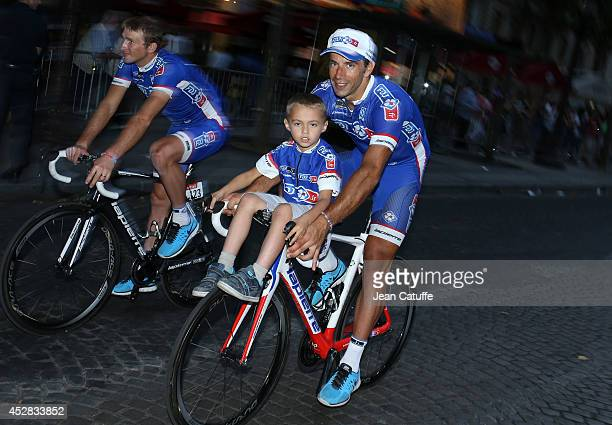 Matthieu Ladagnous of France and FDJfr and his son during the lap of honor after the twenty one and last stage of the 2014 Tour de France a 134 km...