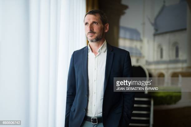 Matthieu Orphelin candidate for the En Marche movement in the 1st district of the Maine et Loire poses during a meeting ahead of the upcoming French...