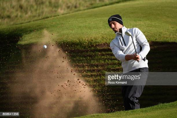 Matthieu Pavon of France plays out of a bunker on the 18th during day three of the 2017 Alfred Dunhill Championship at Kingsbarns on October 7 2017...