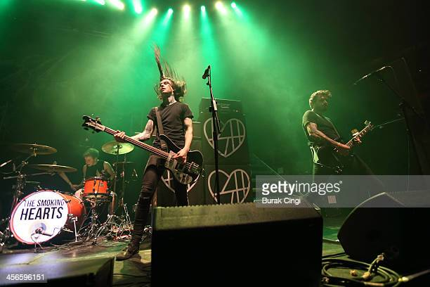 Matthieu Taylor Calvin Roffey and Simon Barker of The Smoking Hearts perform on stage at The Roundhouse on December 14 2013 in London United Kingdom
