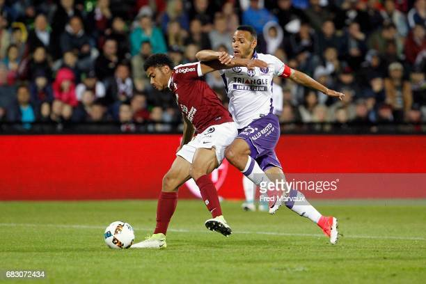 Matthieu Udol of Metz and Martin Braithwaite of Toulouse during the Ligue 1 match between FC Metz and Toulouse FC at Stade SaintSymphorien on May 14...