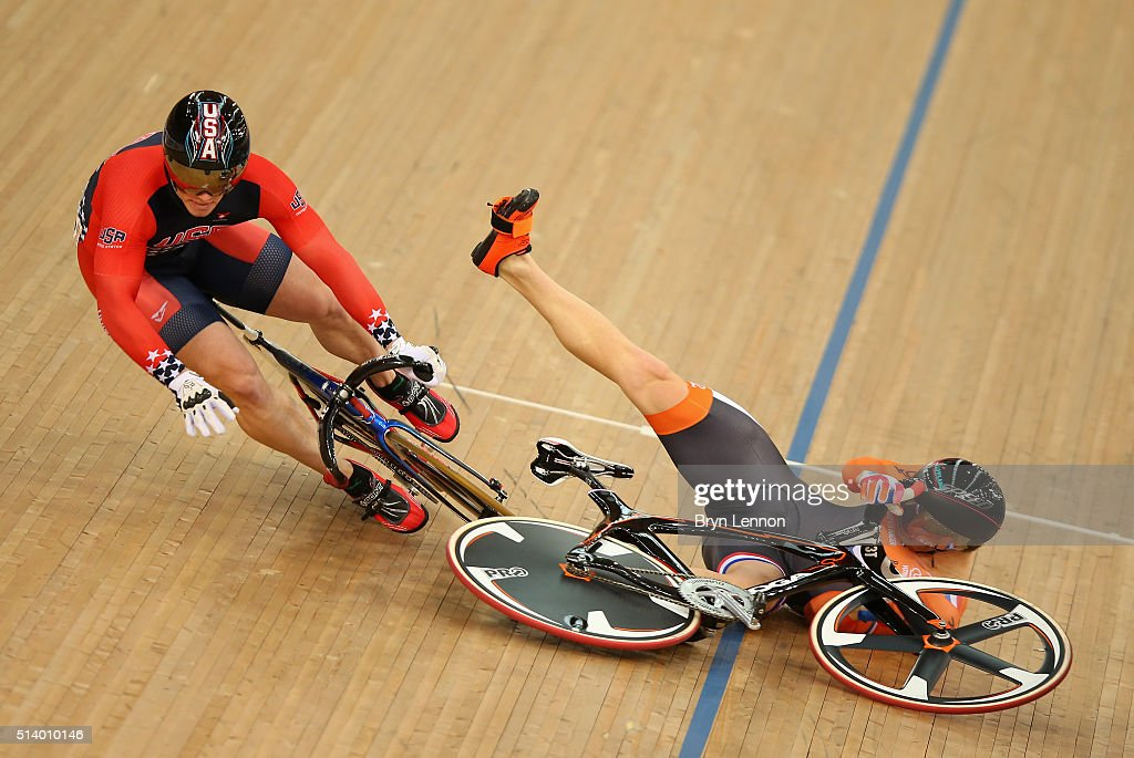 Matthijs Buchli of Holland crashes and takes out USA's Matthew Baranoski in heat three of the Men's Keirin during Day Five of the UCI Track Cycling...