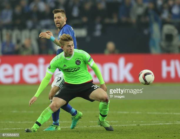 Matthijs de Ligt of Ajax Amsterdam and Guido Burgstaller of Schalke controls the ball during the UEFA Europa League quarter final second leg match...
