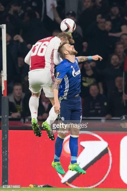 Matthijs de Ligt of Ajax Amsterdam and Guido Burgstaller of Schalke battle for the ball during the UEFA Europa League Quarter Final first leg match...