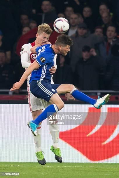 Matthijs de Ligt of Ajax Amsterdam and KlaasJan HUNTELAAR of Schalke battle for the ball during the UEFA Europa League Quarter Final first leg match...