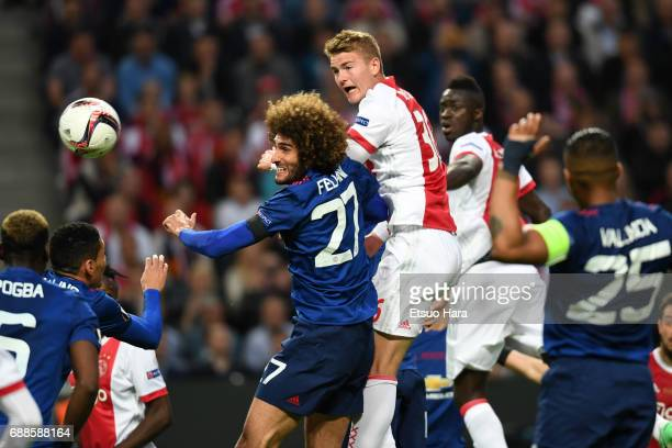 Matthijs de Ligt of Ajax and Marouane Fellaini of Manchester United compete for the ball during the UEFA Europa League final match between Ajax and...