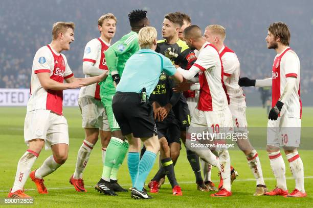 Matthijs de Ligt of Ajax Frenkie de Jong of Ajax Andre Onana of Ajax Marco van Ginkel of PSV Hakim Ziyech of Ajax Referee Kevin Blom Donny van de...