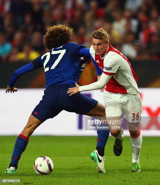 Matthijs de Ligt of Ajax gets away from Marouane Fellaini of Manchester United during the UEFA Europa League Final between Ajax and Manchester United...