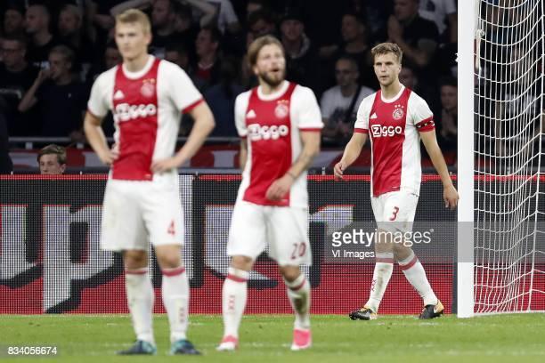 Matthijs de Ligt of Ajax Lasse Schone of Ajax Joel Veltman of Ajax during the UEFA Europa League fourth round qualifying first leg match between Ajax...