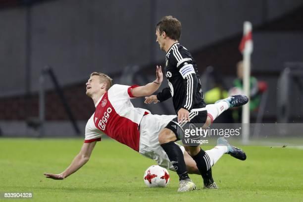 Matthijs de Ligt of Ajax Mike Lindemann Jensen of Rosenborg BK during the UEFA Europa League fourth round qualifying first leg match between Ajax...