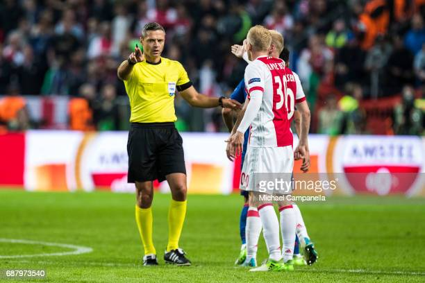 Matthijs de Ligt of Ajax speaks with referee Damir Skomina during the UEFA Europa League final between Ajax and Manchester United at Friends Arena on...