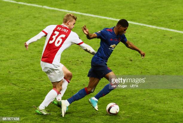 Matthijs de Ligt of Ajax tackles Marcus Rashford of Manchester United during the UEFA Europa League Final between Ajax and Manchester United at...