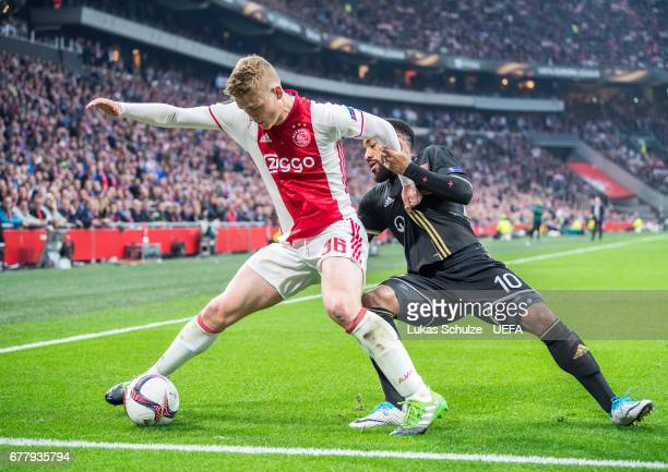 Matthijs de Ligt of Amsterdam is attacked by Alexandre Lacazette of Lyon during the Uefa Europa League semi final first leg match between Ajax...